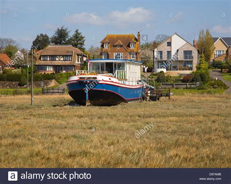 boat house essex houseboats on the shoreline at west mersea mersea island