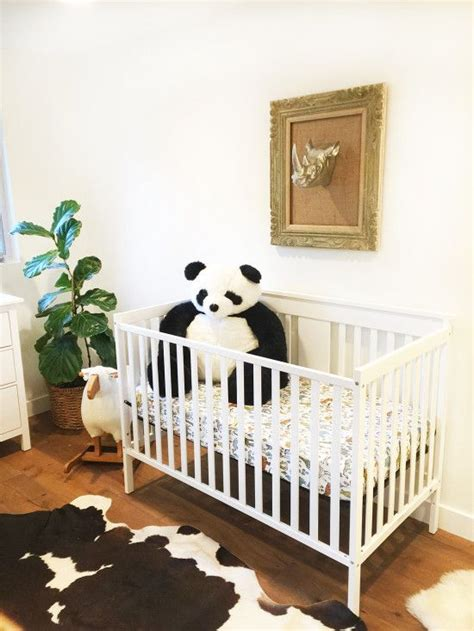 Cowhide Rug Nursery - safari themed nursery with ikea furniture and mounted