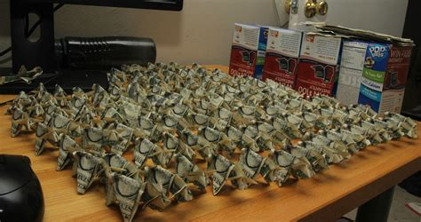 Army Origami - pays ticket with 137 origami pigs made from dollar bills