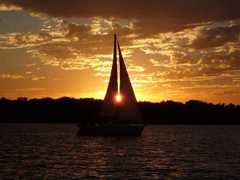 sailboat on lake sunset sailboat on lake travis sailing