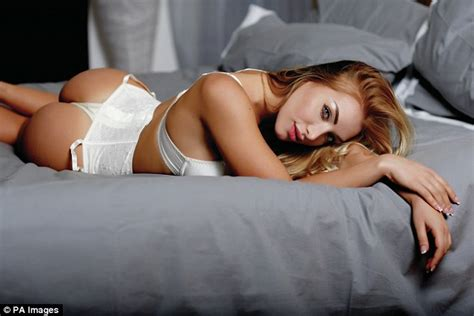 lorena sizzles as she poses on the bed wearing a hot black cristiano ronaldo s rumoured girlfriend elisa de panicis
