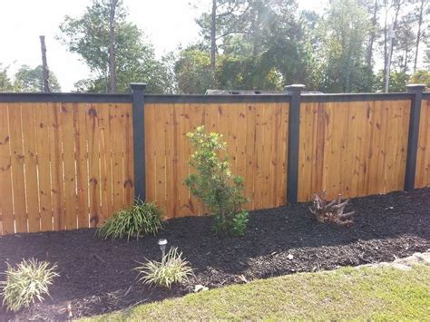 wood fence  black top  black posts elite fencing