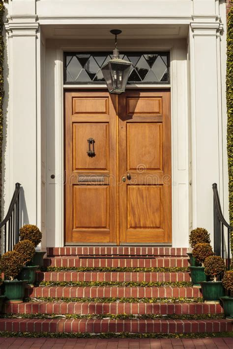 closed modern red exterior door   home stock photo