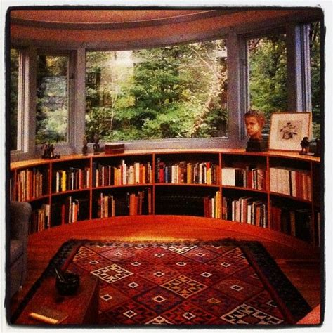 curved window seat and bookshelves in bay window where s