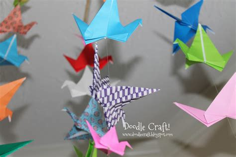 paper folding crafts step by step doodlecraft origami flapping paper crane mobile