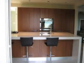 modern kitchen white countertops walnut cabinets