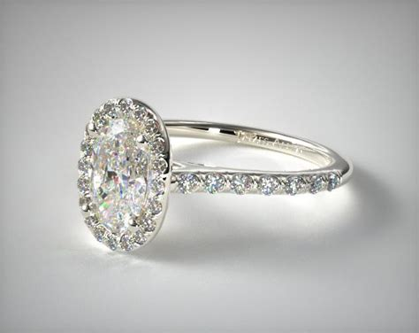 pave halo and shank engagement ring oval center