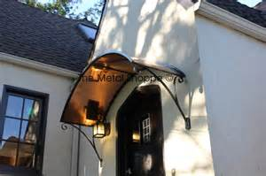 Wrought Iron Awning Brackets Custom Arched Copper And Iron Window Door Awning