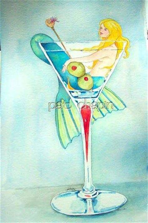martini mermaid mermaid inside a martini glass with 2 olives