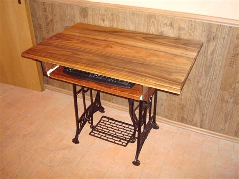 sold  treadle sewing machine computer desks
