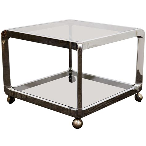 mid century chrome and glass two tier side table with