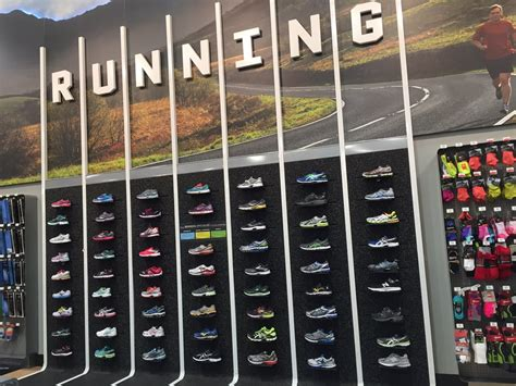 sporting shoes stores wall of running shoes yelp