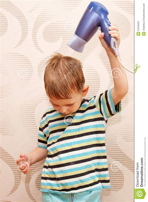 can hair dye be used on lillte boy hair little boy drying hair with hair dryer stock image