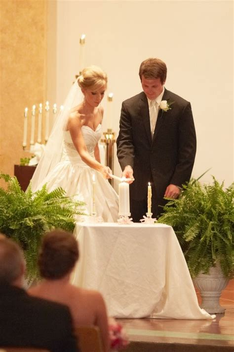 candle lighting ceremony wedding catholic wedding bride and groom using their baptism