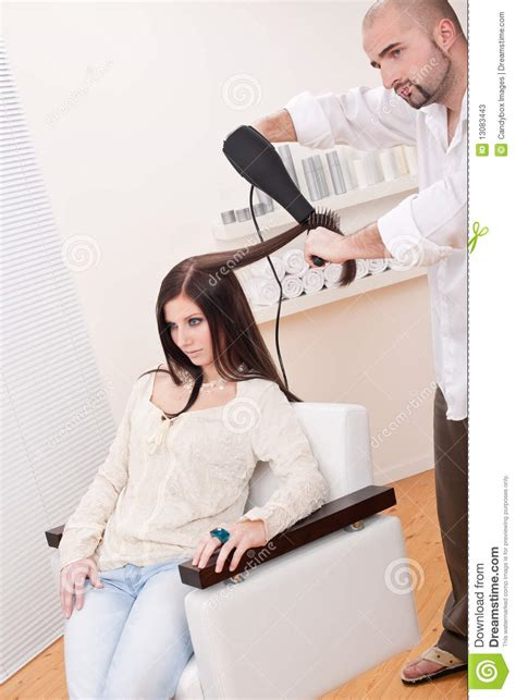 Professional Hair Dresser by Professional Hairdresser With Hair Dryer At Salon Stock