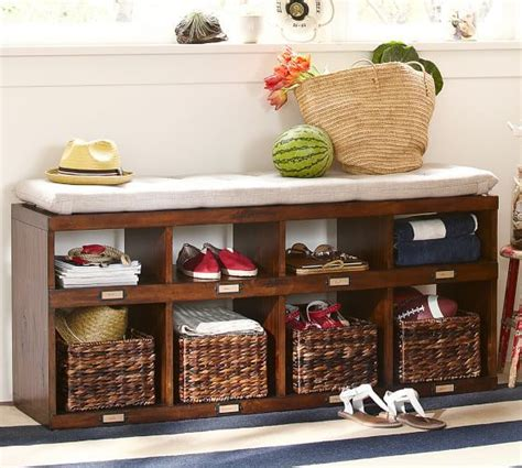 entryway bench with 4 baskets with a pub mirror hooks and shelves above olivia bench