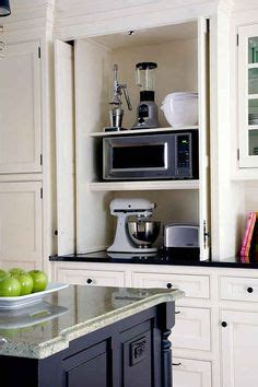 microwave hideaway cabinet for the home pinterest 1000 ideas about microwave cabinet on pinterest built