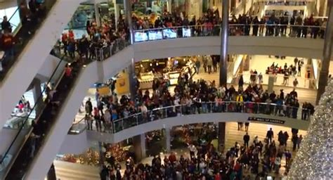 black friday a photo series of america s abandoned man throws 1 000 over balcony in mall of america to a