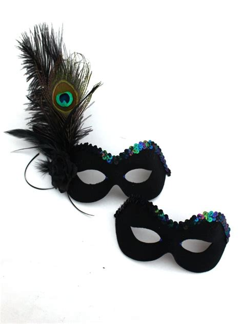 10 Masks To Match Your Black Dress by S Matching Peacock Black Feather Masks