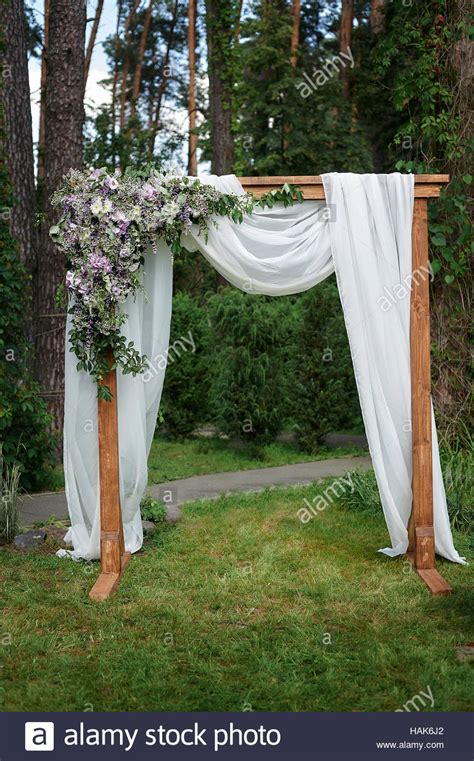 Wedding Arch Decorated With Flowers by Beautiful Wedding Arch Decorated With Flowers In The Park
