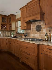 Ideas remodels amp photos with medium tone wood cabinets and an island
