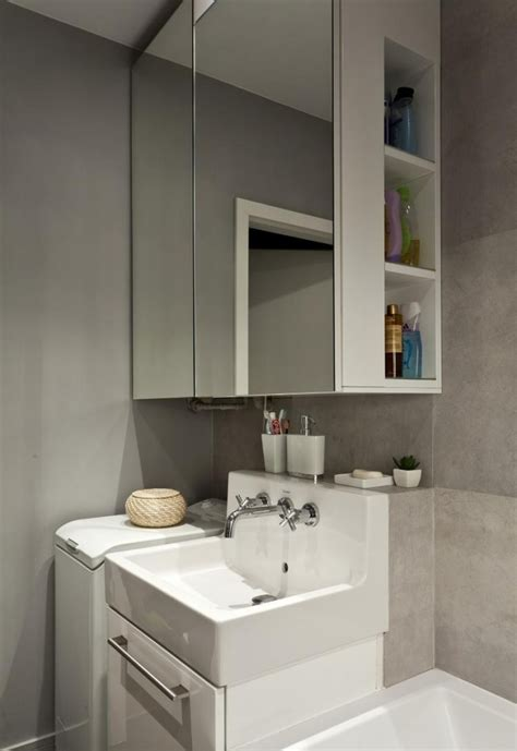 small bathroom ideas neutral color tiles mirror cabinet
