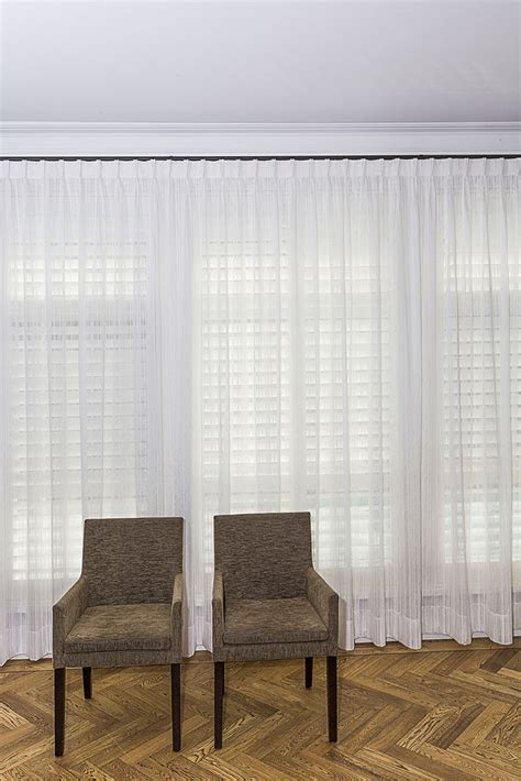 drapes over plantation shutters one of our favourite layering combinations sheer curtains