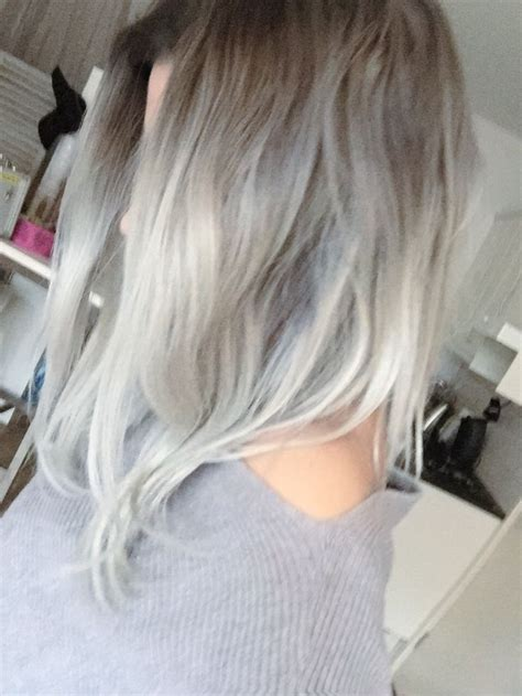 platinum blonde on the bottom and dark blonde om the top grey silver hair dark grey roots and light silver