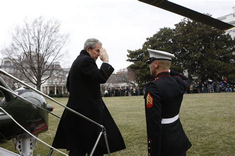 White House Marines by President George W Bush Salutes A U S Marine Crew Member