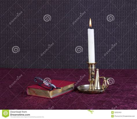 books and glasses with candle stock photos image 32022453