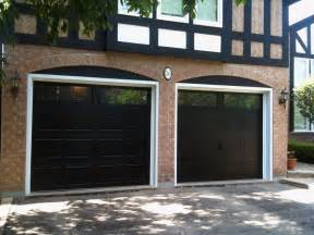 black garage doors with windows for the home garage