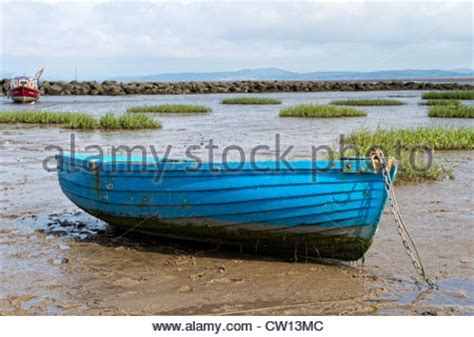red bay boats ltd morecambe bay lancashire with a boat and the tide out