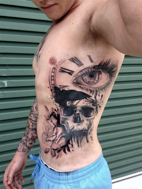 tattoo for guys rose skull eye time piece crow trash