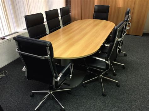 used boardroom table with 8 leather chairs