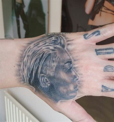 miley cyrus tattoo guy miley cyrus fanatic carl mccoid debuts new portrait tat on