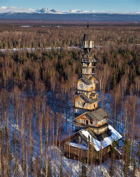 Goose Creek Cabins alaskan attorney builds 185 foot stacked log cabin tower