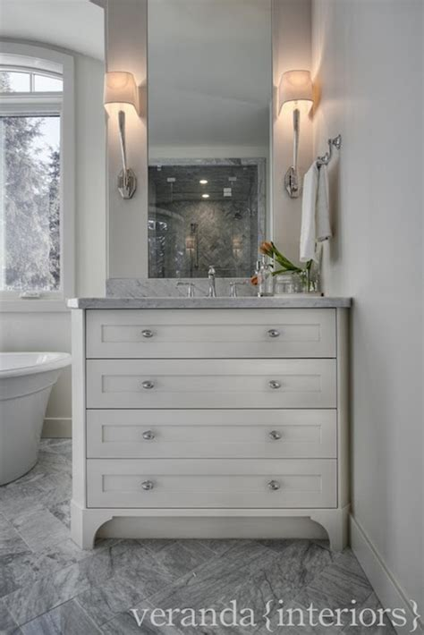 veranda interiors gray marble herringbone tiles transitional bathroom