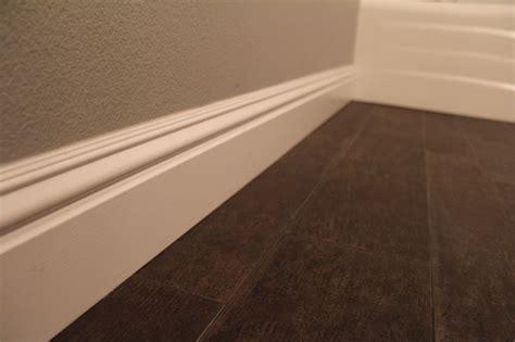 wood baseboard on tile floor baseboard with tile look like wood floor floors