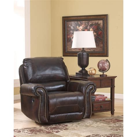 ashley furniture swivel recliner 2100061 ashley furniture dexpen saddle swivel glider
