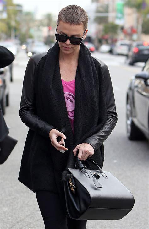 Charlize Theron With And Balenciaga Purses by Charlize Theron Wang Pelican Bag