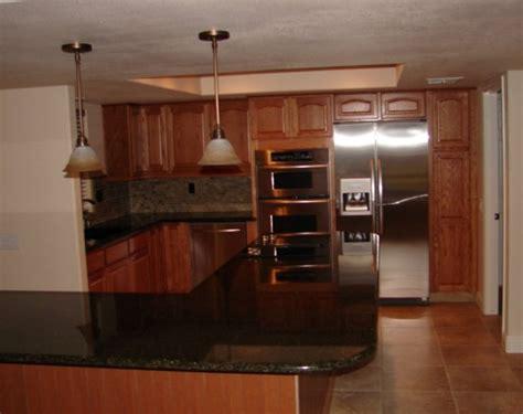 Kraftmaid Countertops by Kraftmaid Fawn Oak Cabinets With Granite Countertop Oak
