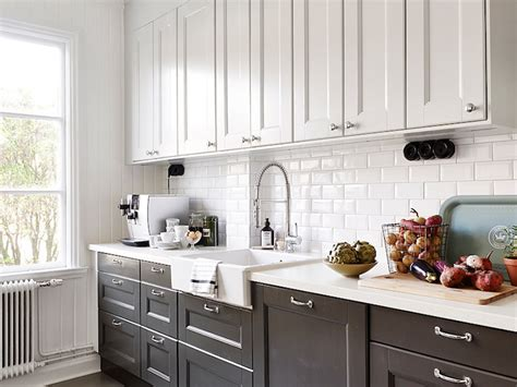 kitchen cabinets white top black bottom white upper cabinets dark lower cabinets transitional