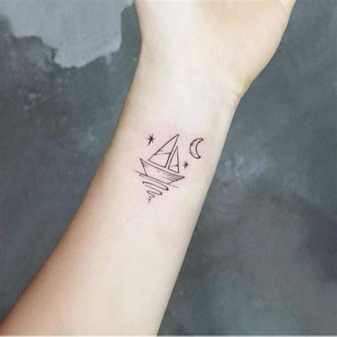 boat hand tattoo small sailboat on the inner wrist tattoo artist ida