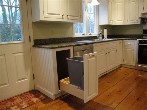 soft white cabinets with rub through traditional