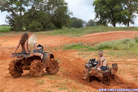 mudding four four girls with fourwheelers atv stuck in mud and wrestling
