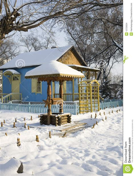 wooden russian house in winter covered with snow stock wooden house in winter stock images image 12723024