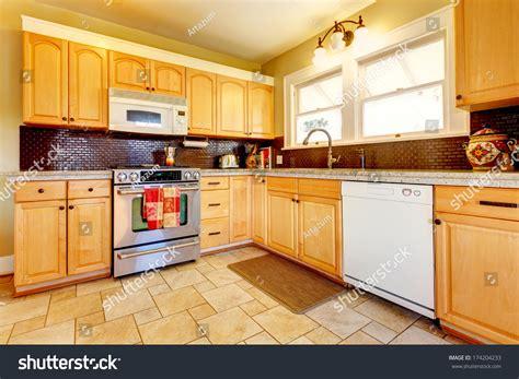 yellow kitchen floor yellow kitchen wood cabinets brown stock photo