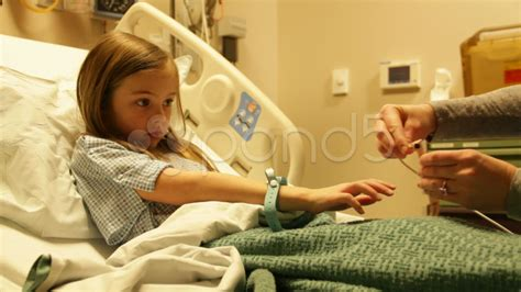 kid in hospital bed sick child in hospital bed with heart monitor hd8499 clip 9651342