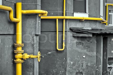 contatore gas in casa yellow gas pipe at the residential house stock photo