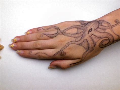 octopus hand tattoo octopus by orangeyyy on deviantart